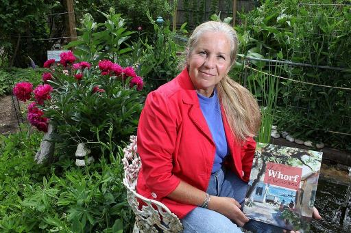 Amy Whorf McGuiggan with book